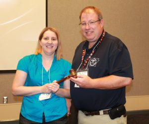 2016 passing of the gavel. Past President Kathy Spencer to Current President Cary Gray.